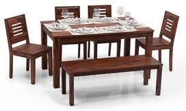 6 seater solid wood Urban Ladder Arabia dining table with bench