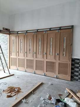 Rel pintu garasi merk Wina  dgn sistem tikung & lipat