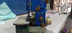 Overlock machine ( Baby lock ).