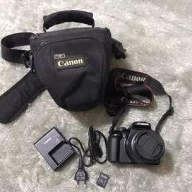 camera CANON 1100D + bag + charger + sandisk