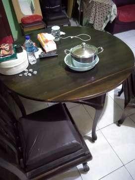 meja makan bundar dan set kursi elegan kayu hitam