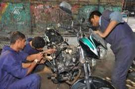 Looking bike mechanic and car mechanic