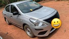 Yellow board Nissan Sunny on Daily rent