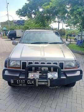 Chrysler Cherokee 4x4 1997 matic Coklat metalik