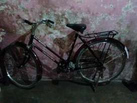 Ladies cycle , red colour , curve handle cycle , 1 year