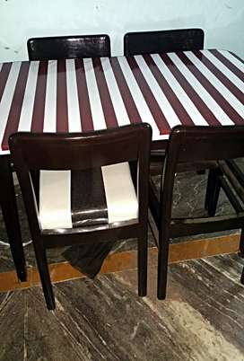 New 4 chairs dining table not used one