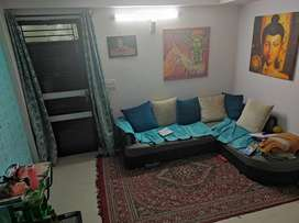A  semi furnished 2bhk apartment with car parking, 24 hours security