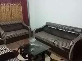 7 seater sofa set with center table.