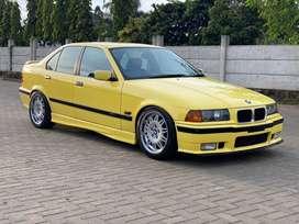 BMW E36 320i a/t 1995 Limited Edition Dakar Yellow on Black