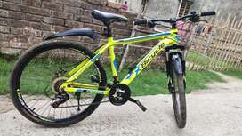 "X BICYCLE 26"" AIR YELLOW 21SpD less than 1 year"