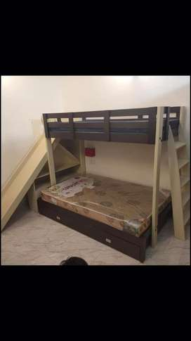 Bunk bed with a slide and a mattress