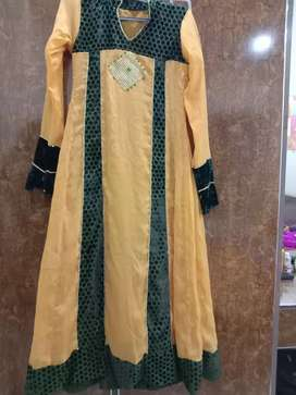 Yellow color frock, with velvet green piping, for 5.7 height girls.