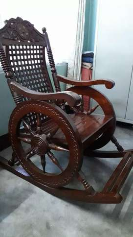 Beautiful wooden rocking chair with hand crafted designs