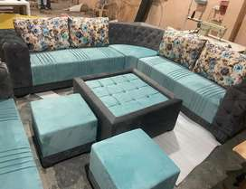 Rich look L shape sofa set with table and 2 puffies.