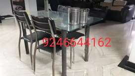 4 chairs glass dining table