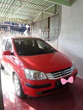 Hyundai Getz, Mulus , Sedan Merah AD Solo