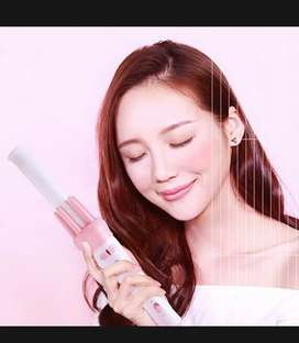 Automatic hair curler rotating rolling iron.