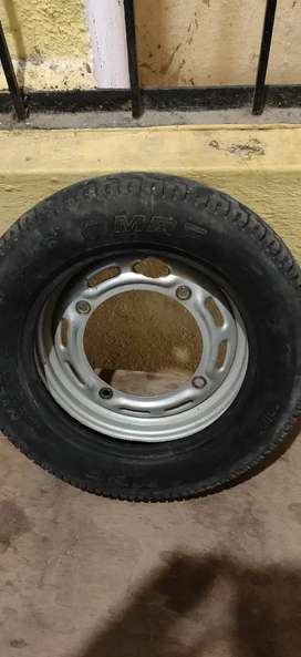 Urgent sale Branded Gently used Branded original Activa rim, MRF tire.