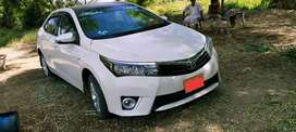 Corolla xli available with driver for monthly basis karachi