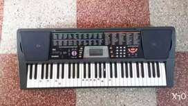 Casio Keyboard with song book