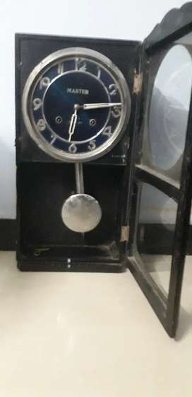 Master key Automatic Pendulam Clock in running and very good condtion