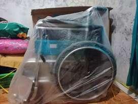 Kursi roda Dan  tongkat