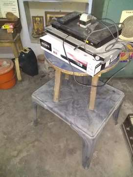 Plastic and wood table with 2 DVD player