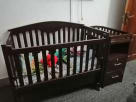 Baby bed with acessories rack