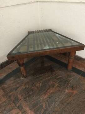 Corner Table cut from old camel cart with glass top