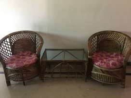 cane sofa chairs and coffee table