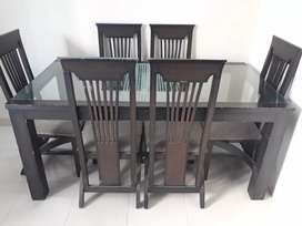 6 Seater Dining Table - Wooden finish with glass top.