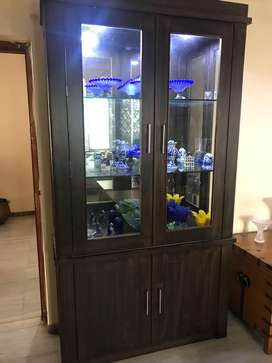 A set of two wooden glass cabinets with book shelf/cupboard