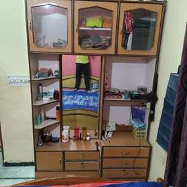 Empty Wooden almira with drawers and a mirror