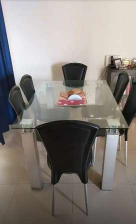 Glass top dining table with 6 Italian leather chairs