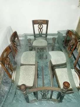 6 person dining table for sale. Pure sheesham made . With glass top.
