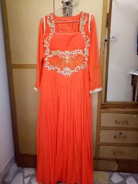 Gown in orange color with naag