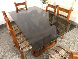 Glass top Dinning table of teak wood with 6 set of chairs