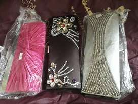 its a pack of 3 fancy clutches from designer zonahs khi.
