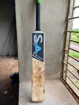 Leather ball bat