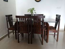 6 seater dining table with sleek glass top(6 chairs and one table )
