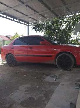 Suzuki baleno merah