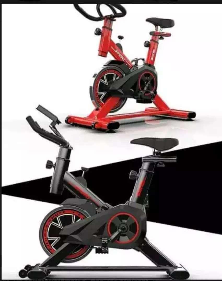 Alat fitnes sepeda statis spinning bike transformer 0