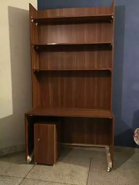 Book shelf with easy moving wheels and (locker if needed).