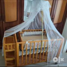 Cradle with crib and mosquito net with storage for