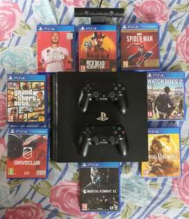 PS4 PRO 1TB WITH 8 GAMES PS CAMERA AND 2 CONTROLLERS
