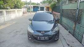 Mazda 2 Tahun 2011. Abu-abu tua metalik. Type 'R' A/T.