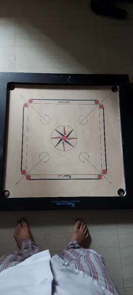 Carrom board along with coins and cover
