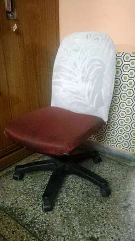 Office Chair with wheels and good condition with cover!