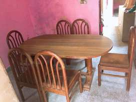 Oval shape wooden dining table