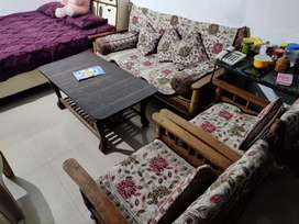 Five sitter wooden sofa set with table and covers